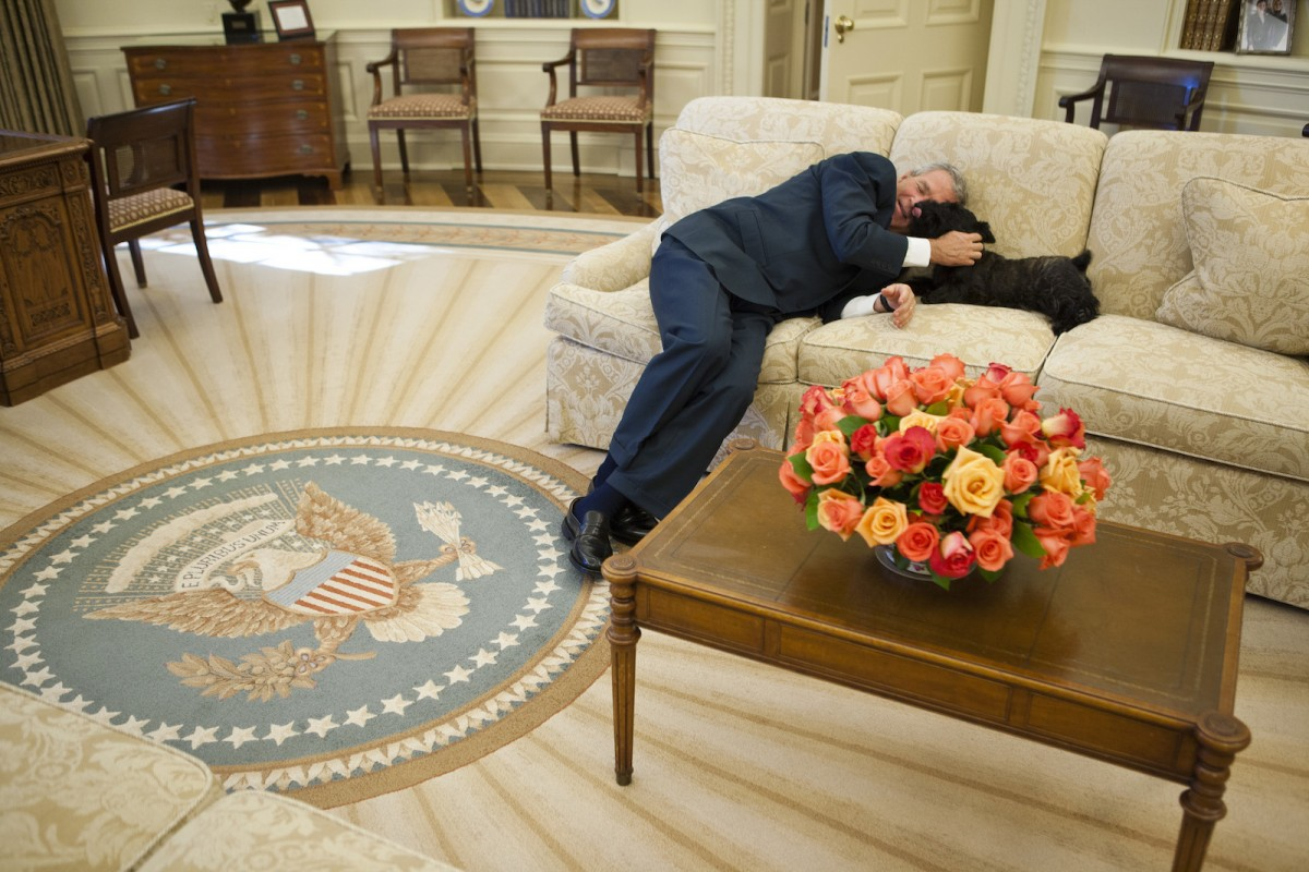 President George W. Bush is joined on the Oval Office couch by Miss Beazley Friday, Oct. 20, 2006, between meetings at the White House.  Photo by Eric Draper, Courtesy of the George W. Bush Presidential Library and Museum