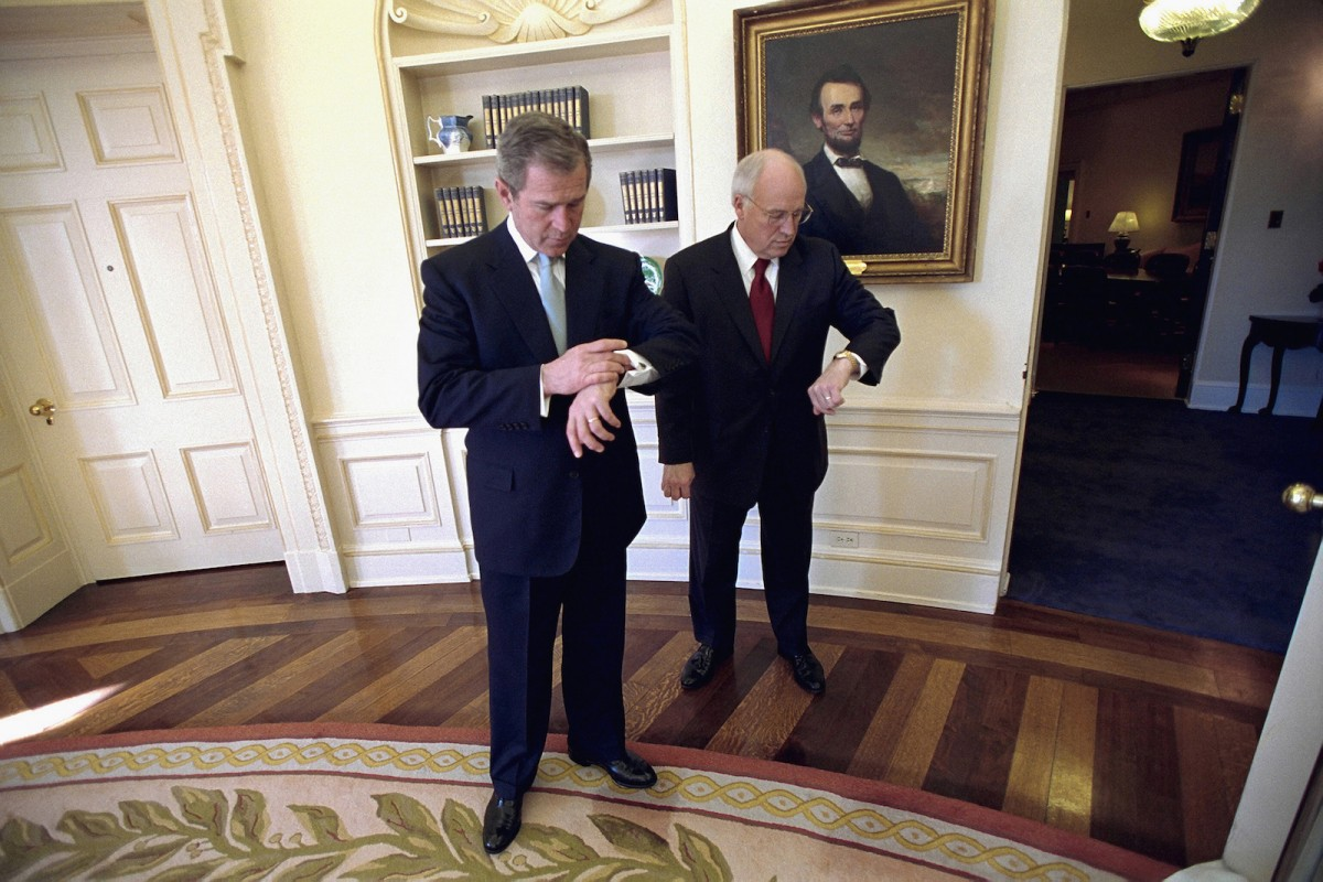 President George W. Bush and Vice President Dick Cheney check their watches in the Oval Office before departing for the swearing-in ceremony for Secretary of State Colin Powell, Jan. 26, 2001. White House Photo by Eric Draper.